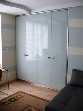 Back painted glass closet doors picture gallery of for Back painted glass designs for wardrobe